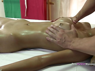 Thai young thai girl receives happy ending oil massage