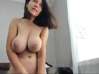 brunette girl with big boobs shows pussy